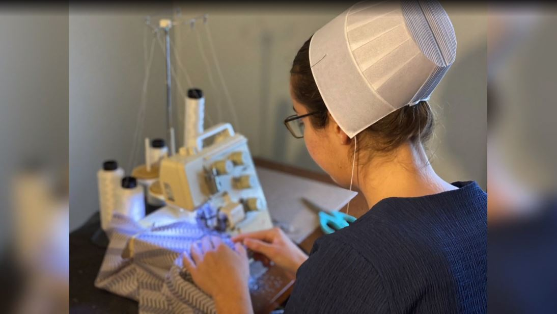 Business owner teams up with the Amish to sew masks, gowns for hospitals