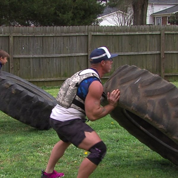 Greensboro father, son set up backyard gym after North Carolina closes all gyms.