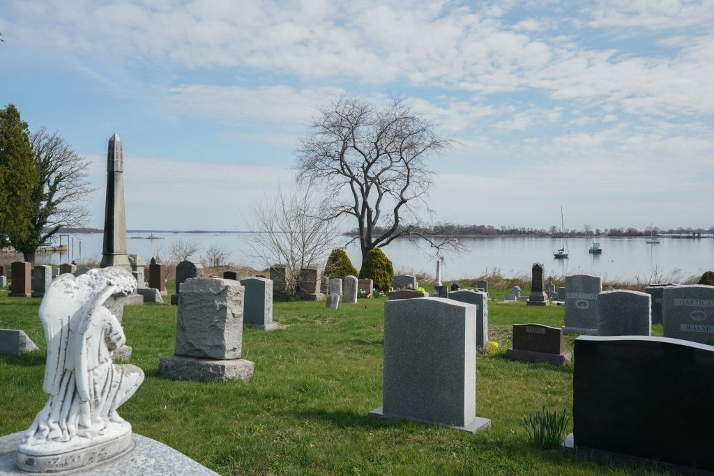 """The Pelham Cemetery on City Island and Hart Island is in Long Island Sound on April 7, 2020 in New York. - Hart Island has been the location of a Union Civil War prison camp, a psychiatric institution, a tuberculosis sanatorium, a potter's field among other uses. The mayor's spokeswoman, Freddi Goldstein, stressed that the city government was not considering using local parks as cemeteries.But she added that Hart Island, where around one million New Yorkers are buried in mass graves, may be used """"for temporary burials, if the need grows."""" Mayor Bill de Blasio himself spoke of the possibility of temporary burials """"to tide us over until the end of the crisis.""""We are not at that point,"""" he told reporters, before refusing to give any more details. (Photo by Bryan R. Smith / AFP) (Photo by BRYAN R. SMITH/AFP via Getty Images)"""