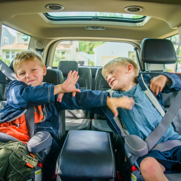 Stock image of kids arguing in car. (Getty Images)