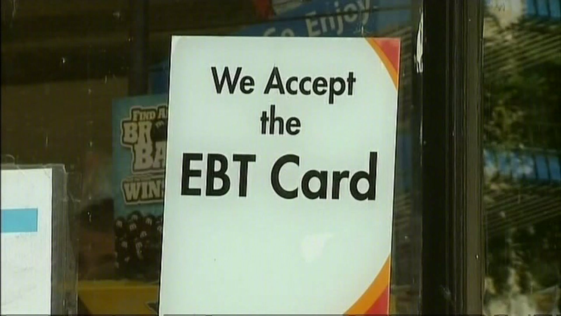 A sign on a store door saying the store accepts EBT cards. (File, WGHP)