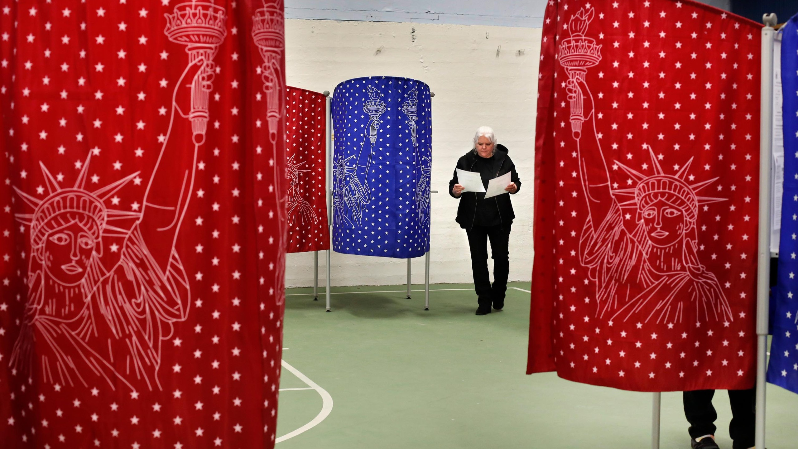 Louise Wilcox checks her ballots after coming out of a booth while voting in the primary election, Tuesday, March 3, 2020, in Mechanic Falls, Maine. (AP Photo/Robert F. Bukaty)
