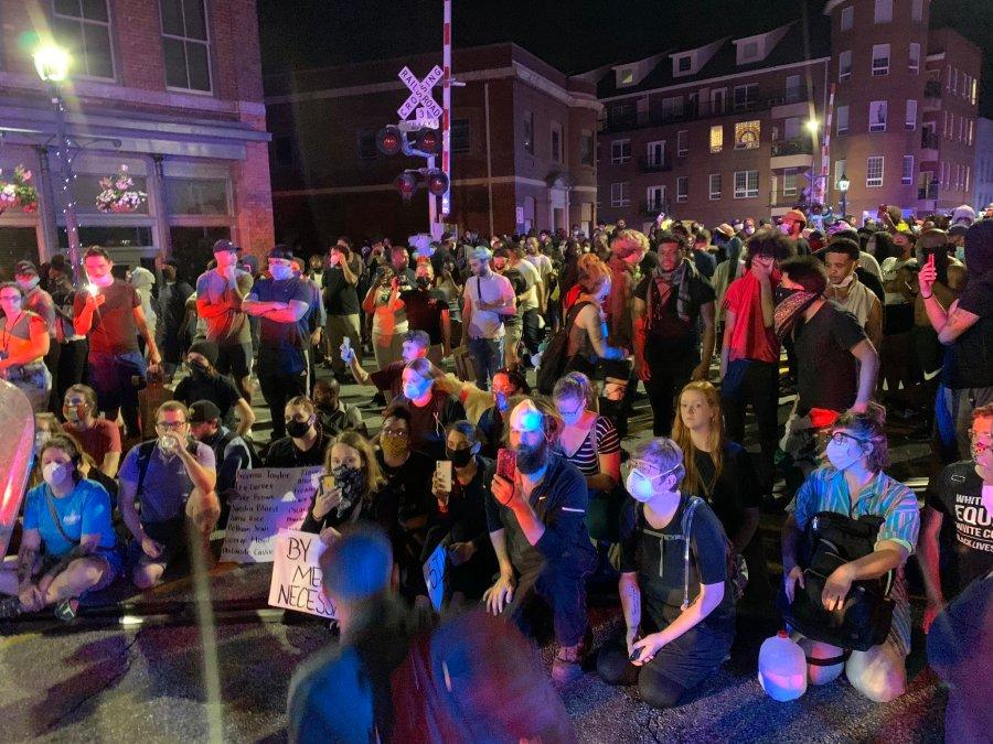 Police and protestors on Elm Street (Lori Denberg/WGHP)