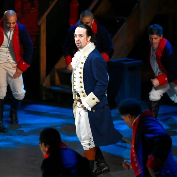 """In this June 12, 2016 file photo, Lin-Manuel Miranda and the cast of """"Hamilton"""" perform at the Tony Awards in New York. Next year, you'll be able to see the original Broadway cast of """"Hamilton"""" perform the musical smash from the comfort of a movie theater. The Walt Disney Company said Monday, Feb. 3, 2020, it will distribute a live capture of Lin-Manuel Miranda's show in the United States and Canada on Oct. 15, 2021. (Photo by Evan Agostini/Invision/AP, File)"""