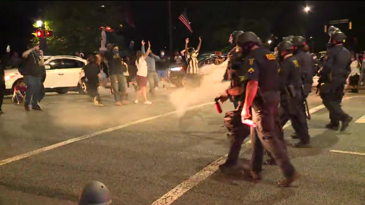 High Point police use pepper spray to disperse protestors blocking South Main Street
