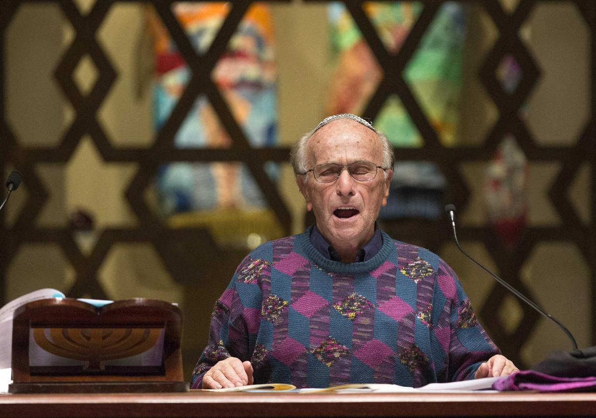 Hank Brodt, a survivor of five Nazi concentration camps and a forced labor camp, sings V'Shamru at the 20th annual Martin Luther King Jr. Shabbat at Temple Emanuel on Jan. 15 in Greensboro. (credit: Lynn Hey/News & Record)