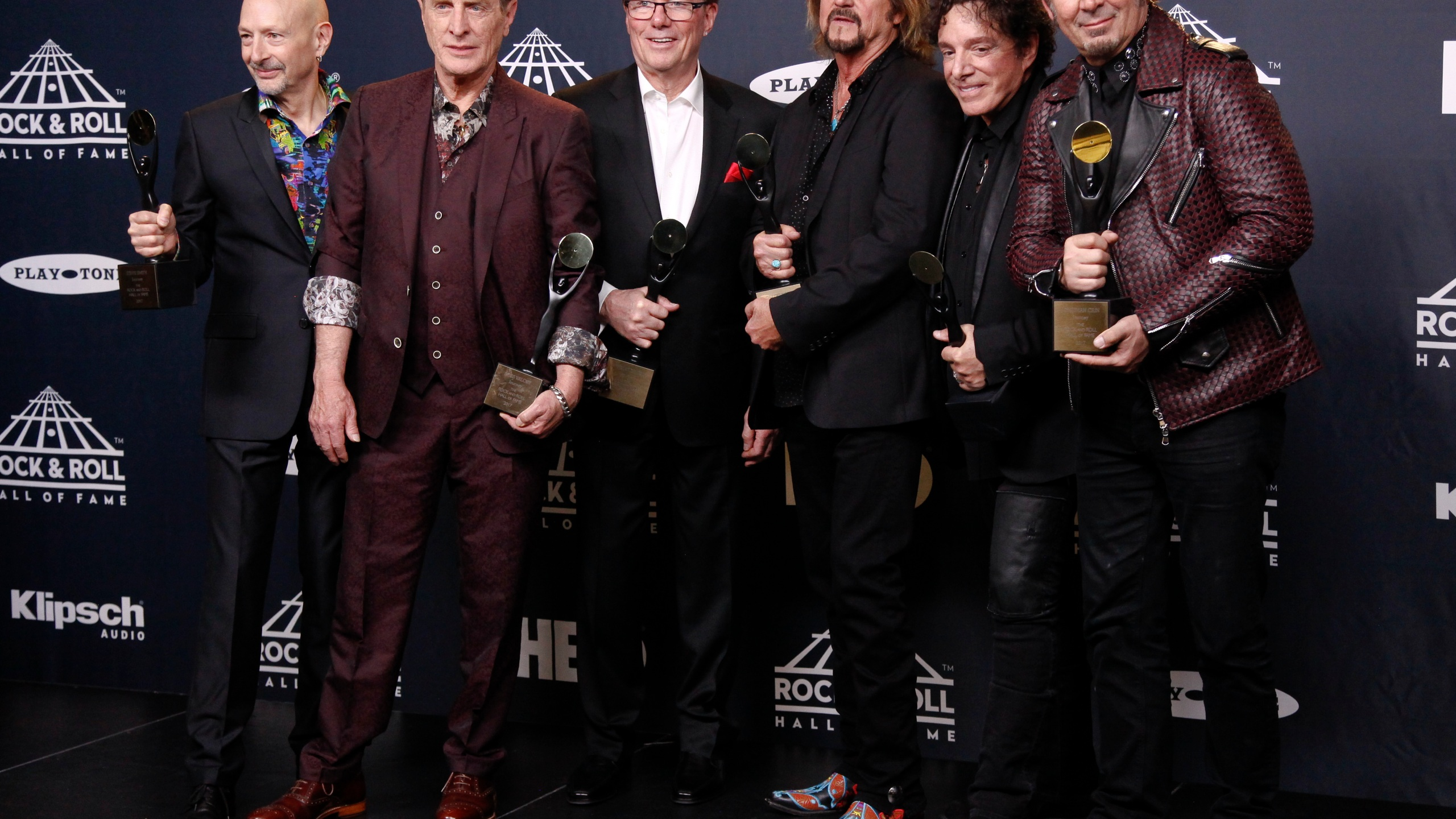 This April 7, 2017 file photo shows members of Journey, Steve Smith, from left, Ross Valory, Aynsley Dunbar, Gregg Rolie, Neal Schon and Jonathan Cain at the 2017 Rock and Roll Hall of Fame induction ceremony in New York. Journey is the latest act to cancel their 2020 tour because of the coronavirus pandemic. The rock band was supposed to kick off their new tour on May 15 but announced Monday that they would no longer hit the road. Band members said they decided to cancel the tour, instead of postponing it, so that concertgoers would qualify for immediate refunds. (Photo by Andy Kropa/Invision/AP, File)