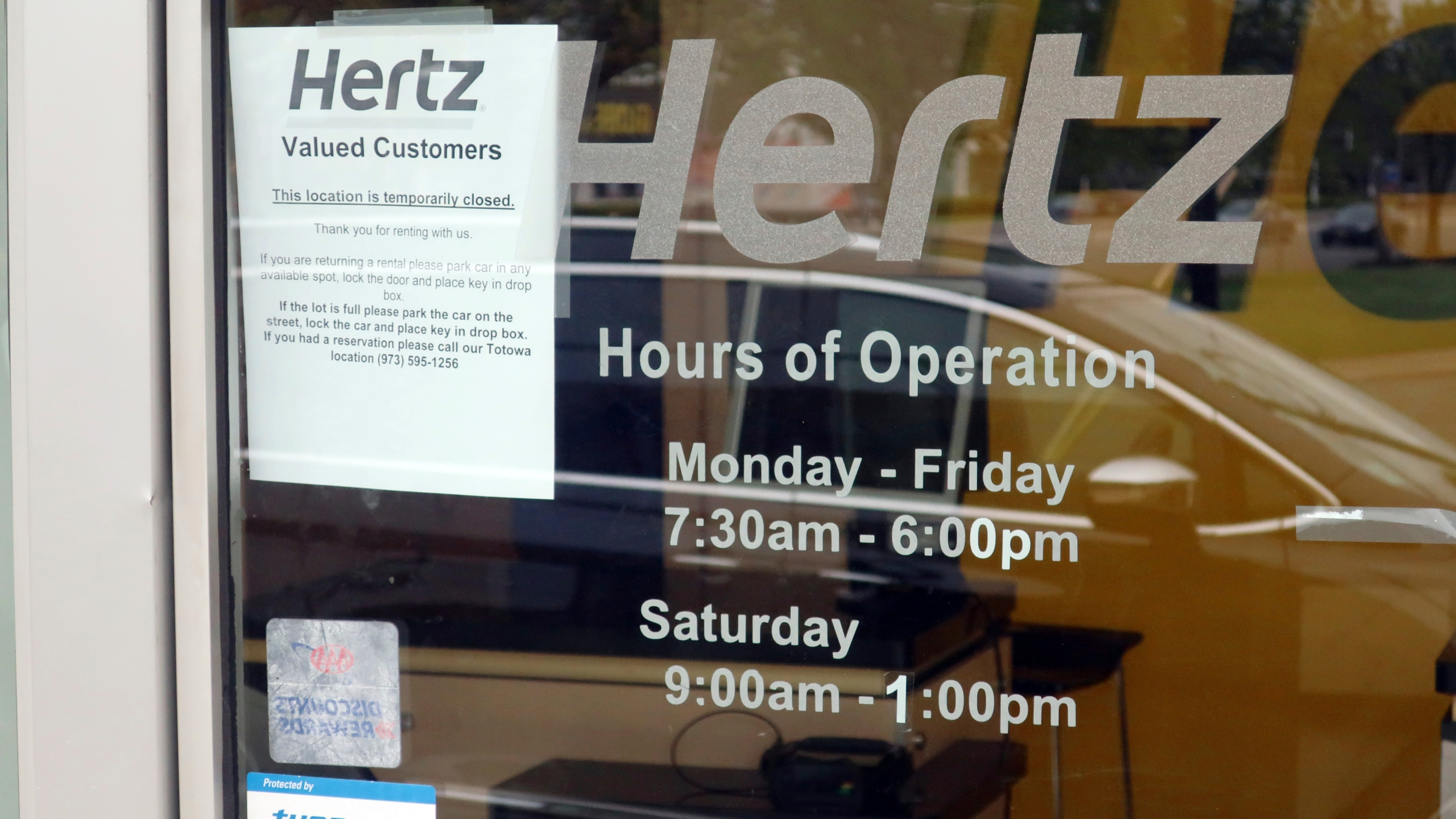 A Hertz Car Rental is closed during he coronavirus pandemic on Wednesday, May 6, 2020 in Paramus, N.J. (AP Photo/Ted Shaffrey)