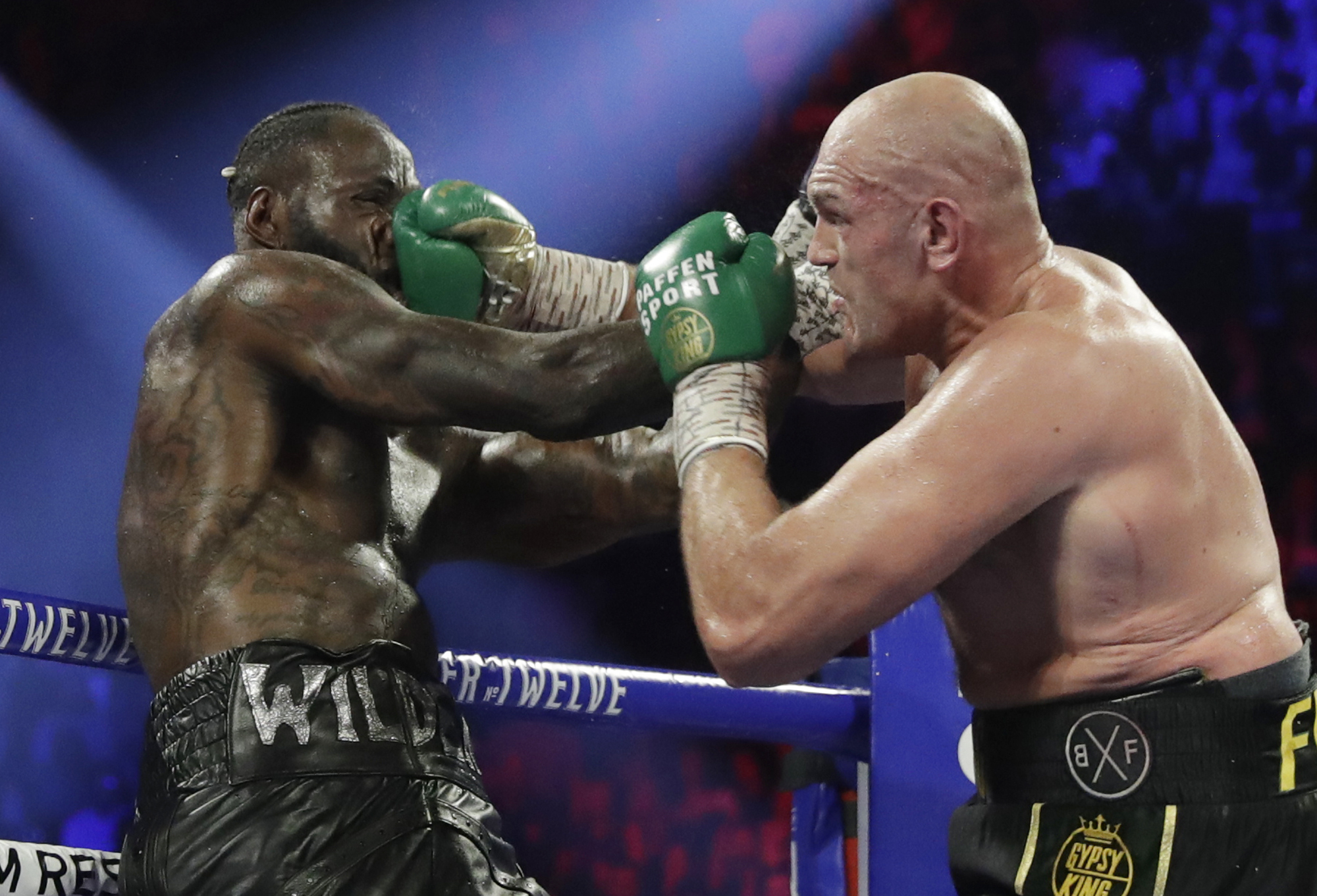 In this Feb. 22, 2020, file photo, Tyson Fury, of England, lands a right to Deontay Wilder, left, during a WBC heavyweight championship boxing match in Las Vegas. Boxing promoter Bob Arum says he plans to stage a card of five fights on June 9 at the MGM Grand. It's the first of a series of fights over the next two months at the Las Vegas hotel. A second fight card will be held two nights later. ESPN will televise both cards to kick off twice weekly shows at the hotel in June and July. The fights are pending approval of the Nevada Athletic Commission. (AP Photo/Isaac Brekken, File)