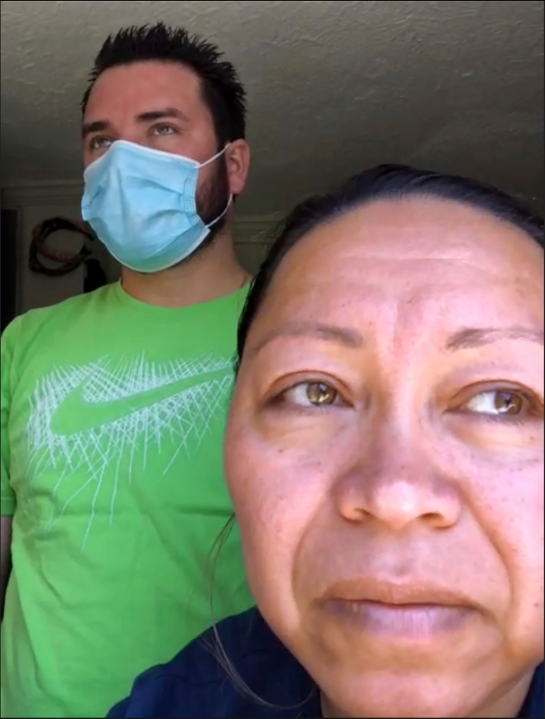 Screen grab shows a portrait from a Zoom interview with Roberto, left, and Janeth, who have both tested positive for COVID-19, Wednesday, May 13, 2020, in Washington. Janeth and her husband Roberto, as well as her sister Arely in Baltimore, have all been diagnosed with COVID-19. (AP Photo/Jacquelyn Martin)