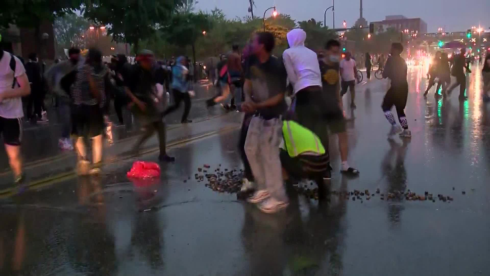 Police spray tear gas as hundreds protest after George Floyd's arrest, death in Minneapolis