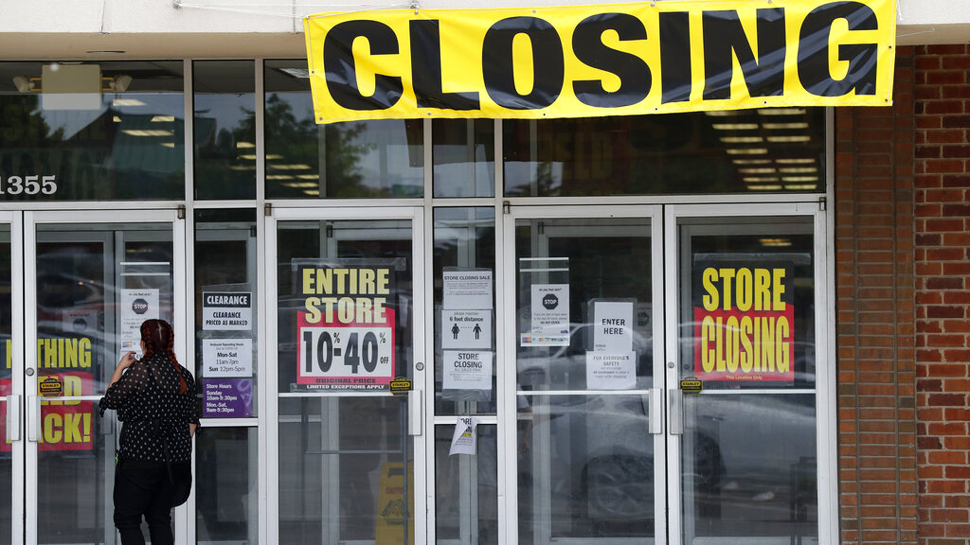 A woman walks into a closing Gordmans store, Thursday, May 28, 2020, in St. Charles, Mo. (AP Photo/Jeff Roberson)