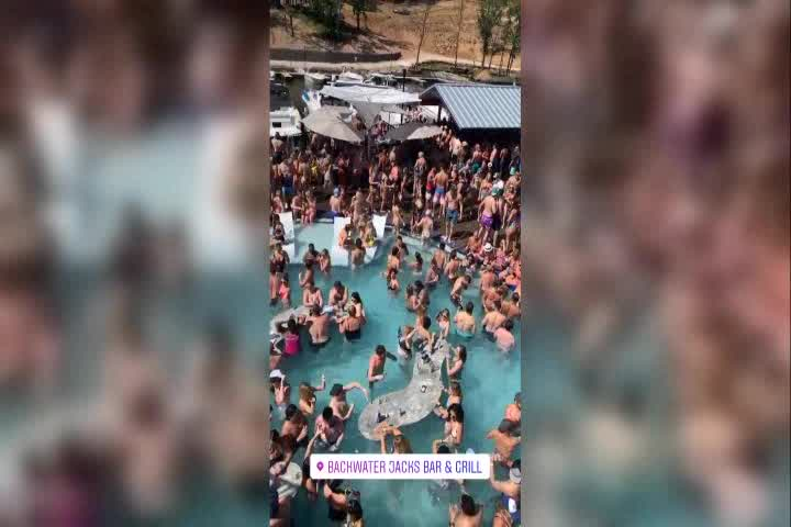 Video shows crowd packing a pool party despite social distancing recommendations