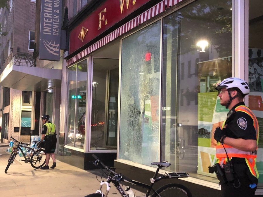 Police officers stand near a broken pane of glass at the International Civil Rights Center & Museum (Michelle Wolf/WGHP)