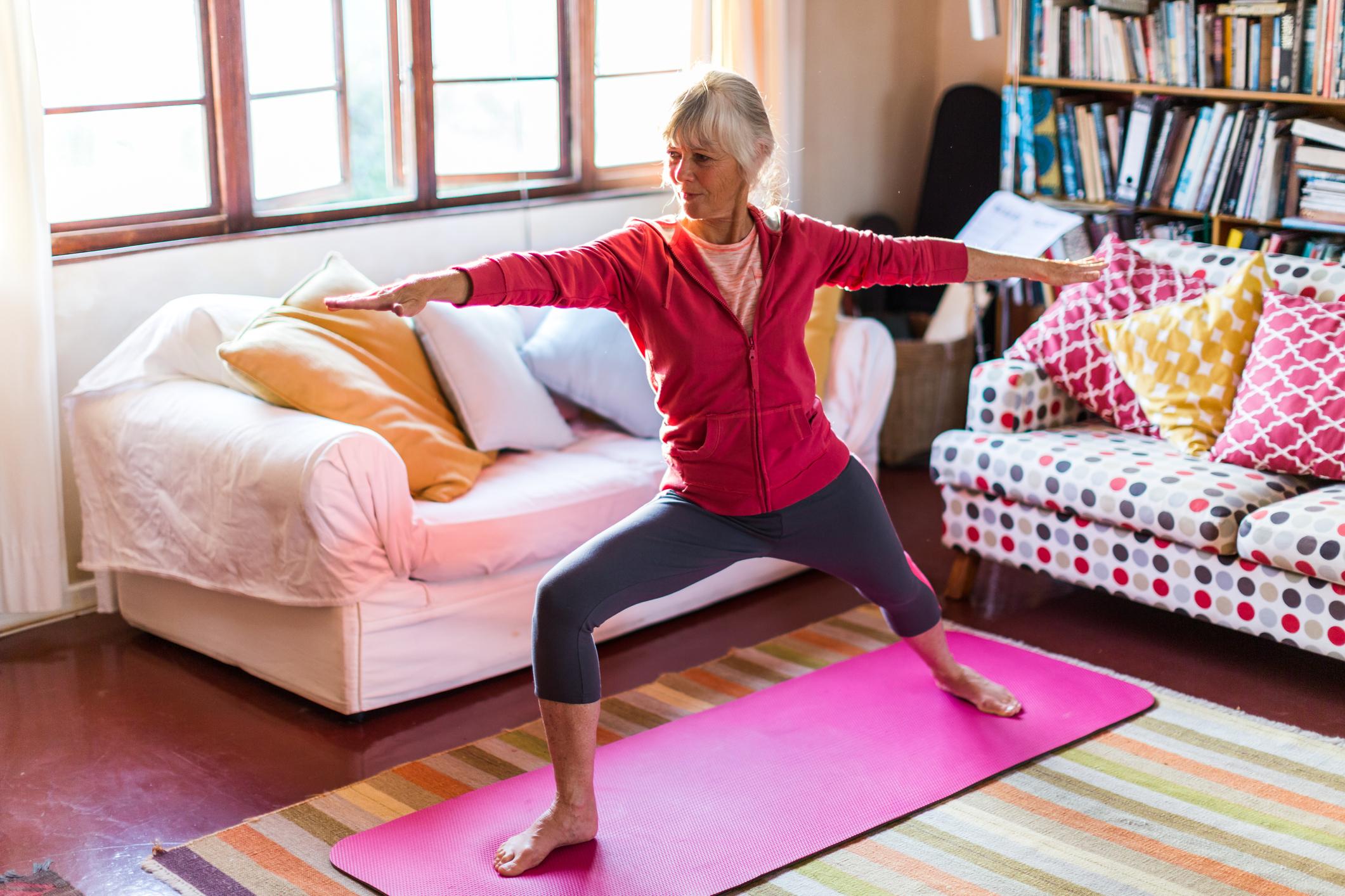 Senior woman doing yoga. (Getty Images)