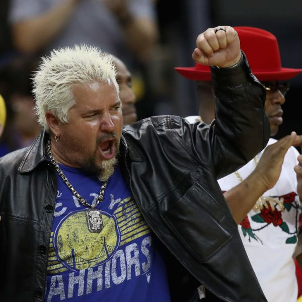 OAKLAND, CA - APRIL 24: Celebrity chef Guy Fieri cheers for the Golden State Warriors during Game Five against the San Antonio Spurs of Round One of the 2018 NBA Playoffs at ORACLE Arena on April 24, 2018 in Oakland, California. NOTE TO USER: User expressly acknowledges and agrees that, by downloading and or using this photograph, User is consenting to the terms and conditions of the Getty Images License Agreement. (Photo by Ezra Shaw/Getty Images)