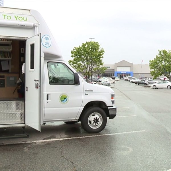 Rockingham County Public Library bookmobile stopping at busy shopping centers