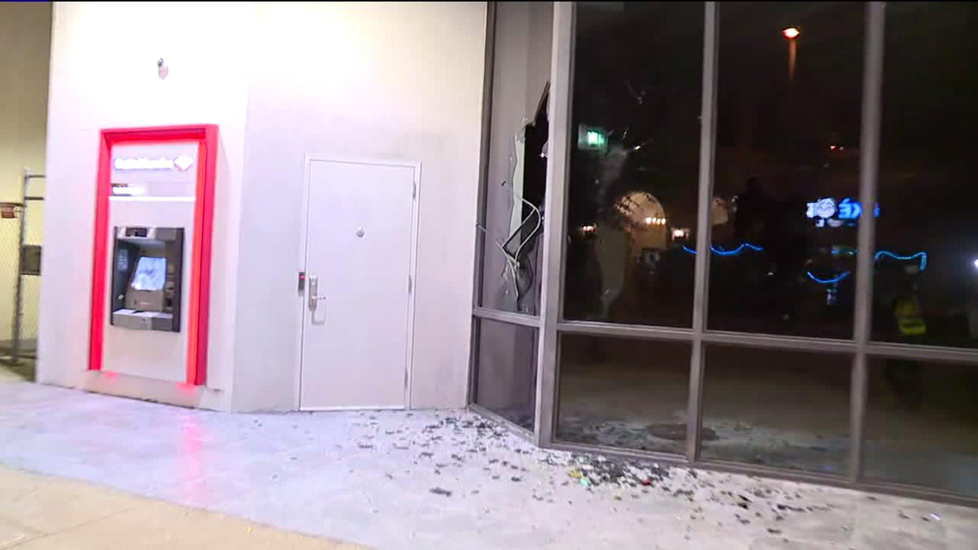Protestors smash windows, litter streets with trash bins in downtown Greensboro