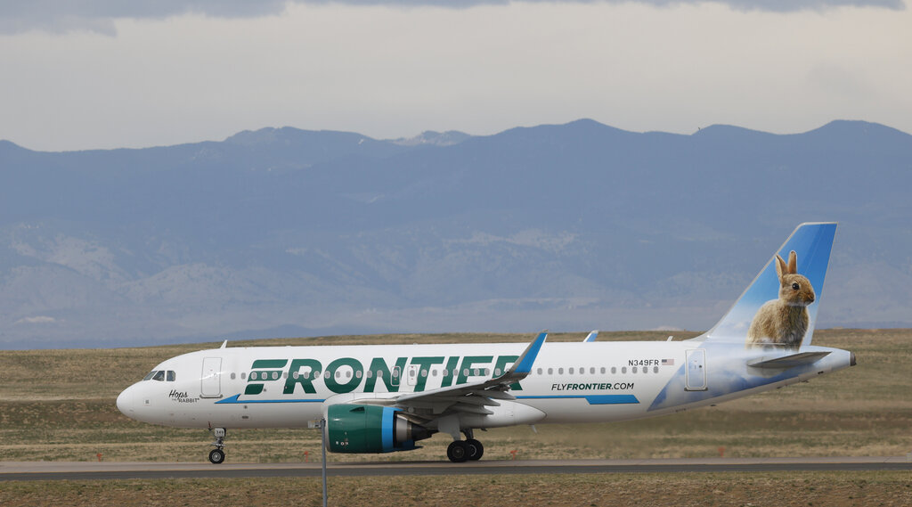 A Frontier Airlines jetl taxis for takeoff from Denver International Airport in Denver. Lawmakers on Capitol Hill lashed out Wednesday against the airline over the budget carrier's move to charge passengers extra to guarantee they will sit next to an empty middle seat while flying during the coronavirus outbreak. (AP Photo/David Zalubowski)