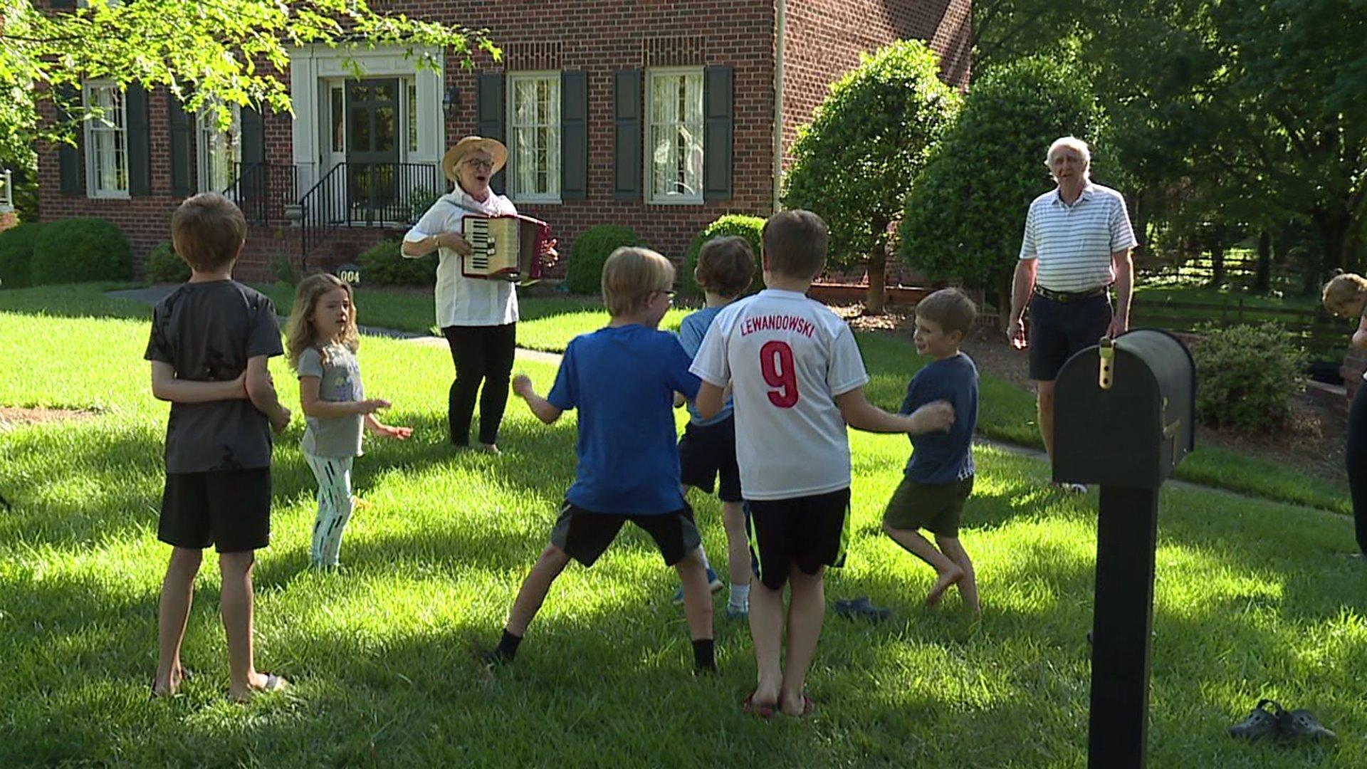 Winston-Salem couple entertains neighborhood children with musical performances