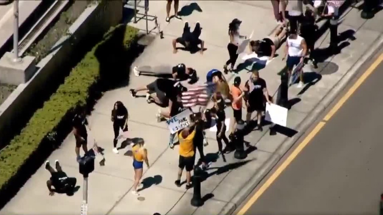 Protesters calling for gyms to reopen do squats, push-ups outside Florida courthouse