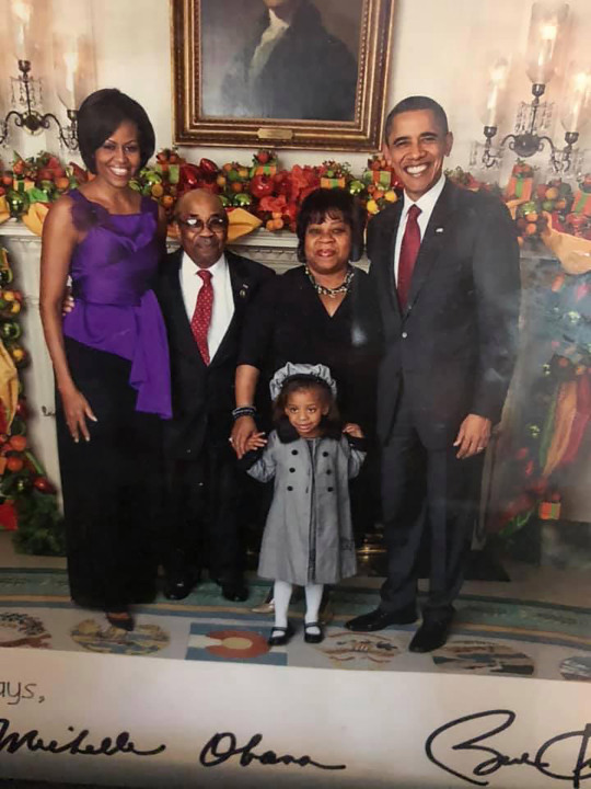 Former White House butler Wilson Roosevelt Jerman with then-President Barack Obama and First Lady Michelle Obama. Courtesy Shanta Taylor Gay