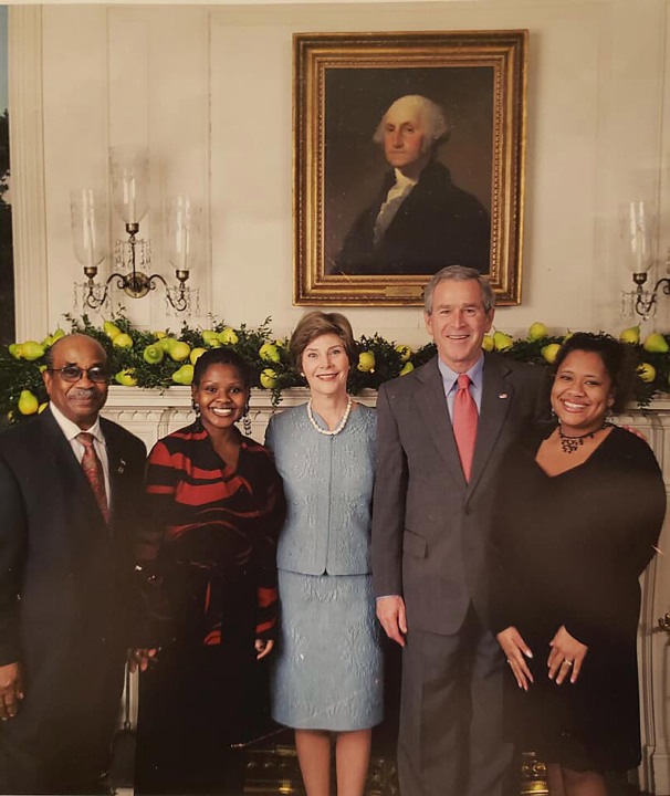 Former White House butler Wilson Roosevelt Jerman with then-President George W. Bush and First Lady Laura Bush. Courtesy Shanta Taylor Gay