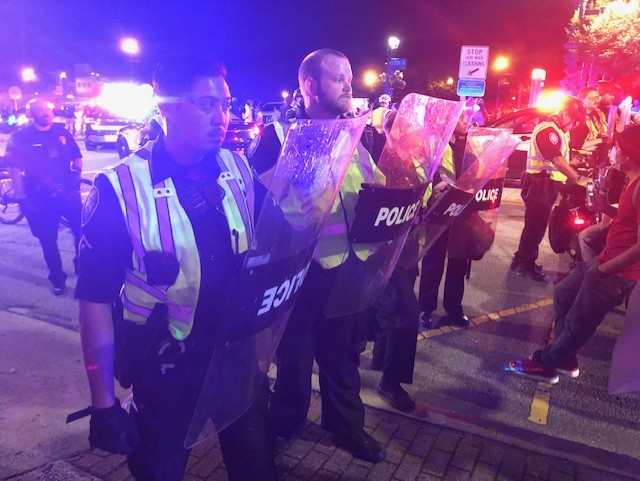 Police and protesters on Elm Street (Nelson Kepley/WGHP)