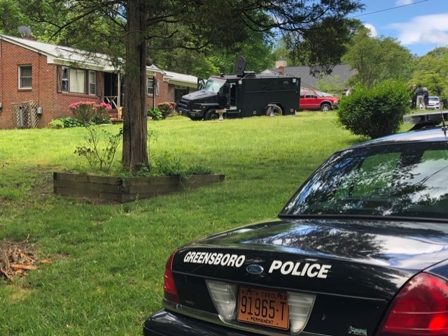 Greensboro police responding to standoff on Gilmore Drive; suspect barricaded, police say (Nelson Kepley/WGHP)