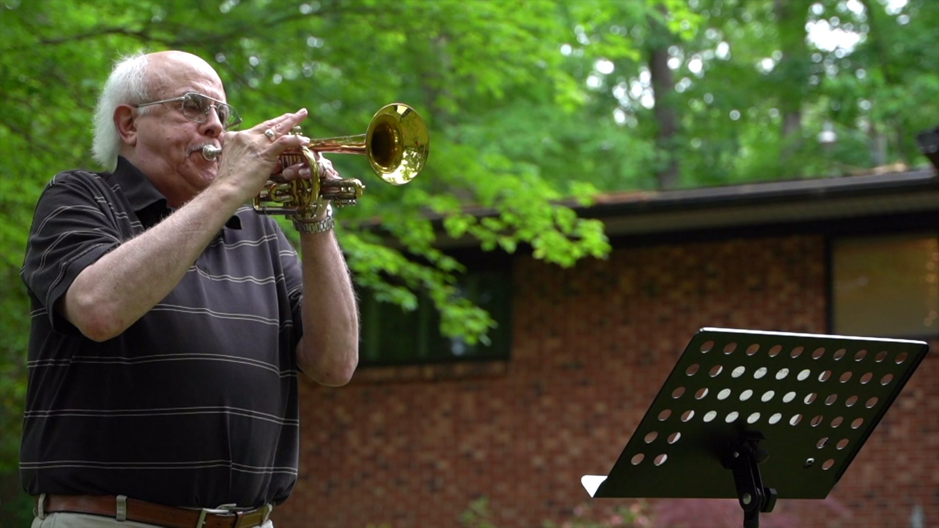 Retired Davidson County teacher brings live music to his neighbors with trumpet shows