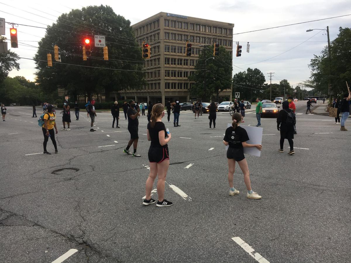 Marchers shut down five points intersection on South Stratford as protests continue in Winston-Salem (Allison Lee Isley/Journal)