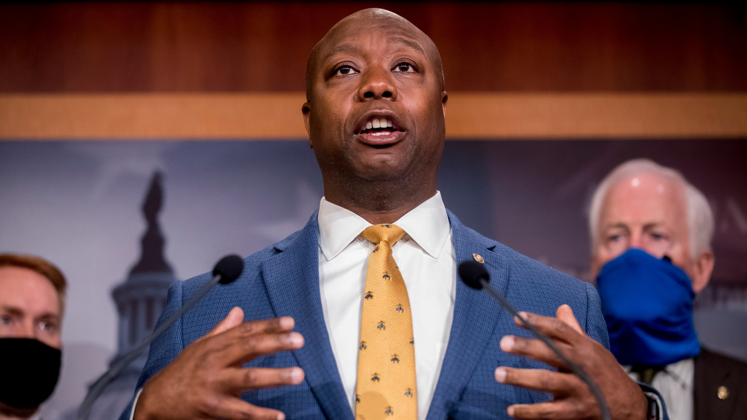 In this June 17, 2020, file photo, Sen. Tim Scott, R-S.C., accompanied by Republican senators speaks at a news conference to announce a Republican police reform bill on Capitol Hill in Washington. Initially reluctant to speak on race, Scott is now among the Republican Party's most prominent voices teaching his colleagues what it's like to be a Black man in America. (AP Photo/Andrew Harnik, File)