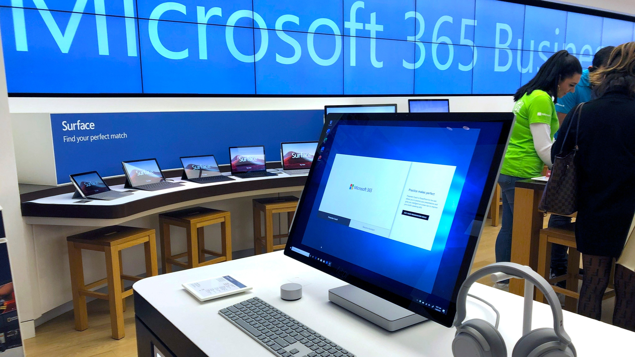 FILE - In this Jan. 28, 2020, file photo a Microsoft computer is among items displayed at a Microsoft store in suburban Boston. Microsoft said Friday, June 26, it is permanently closing nearly all of its physical stores around the world. Like other retailers, the software and computing giant had to temporarily close all of its stores in late March due to the COVID-19 pandemic. (AP Photo/Steven Senne, File)