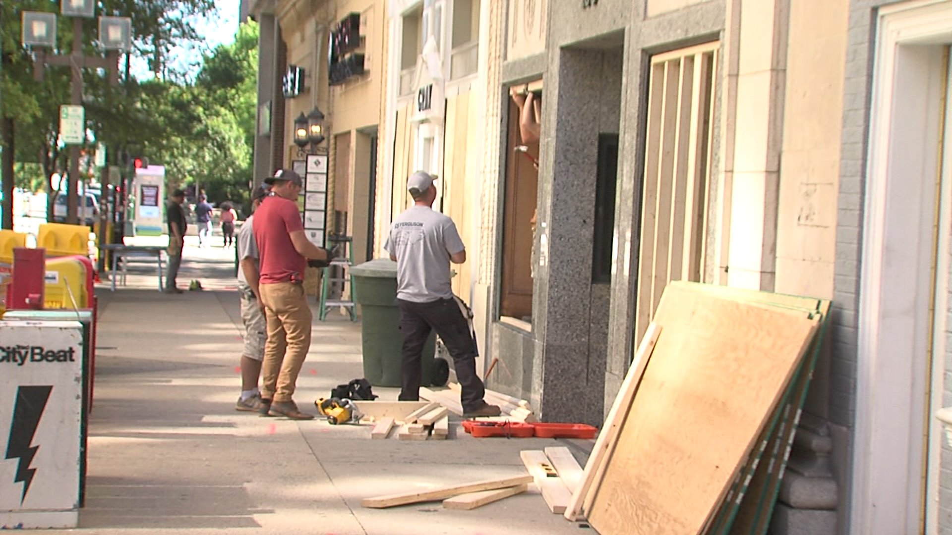 People living and working in downtown Greensboro spent another morning cleaning up glass, debris and damage after people broke away from what started as a peaceful protest in downtown Greensboro and started damaging several businesses.
