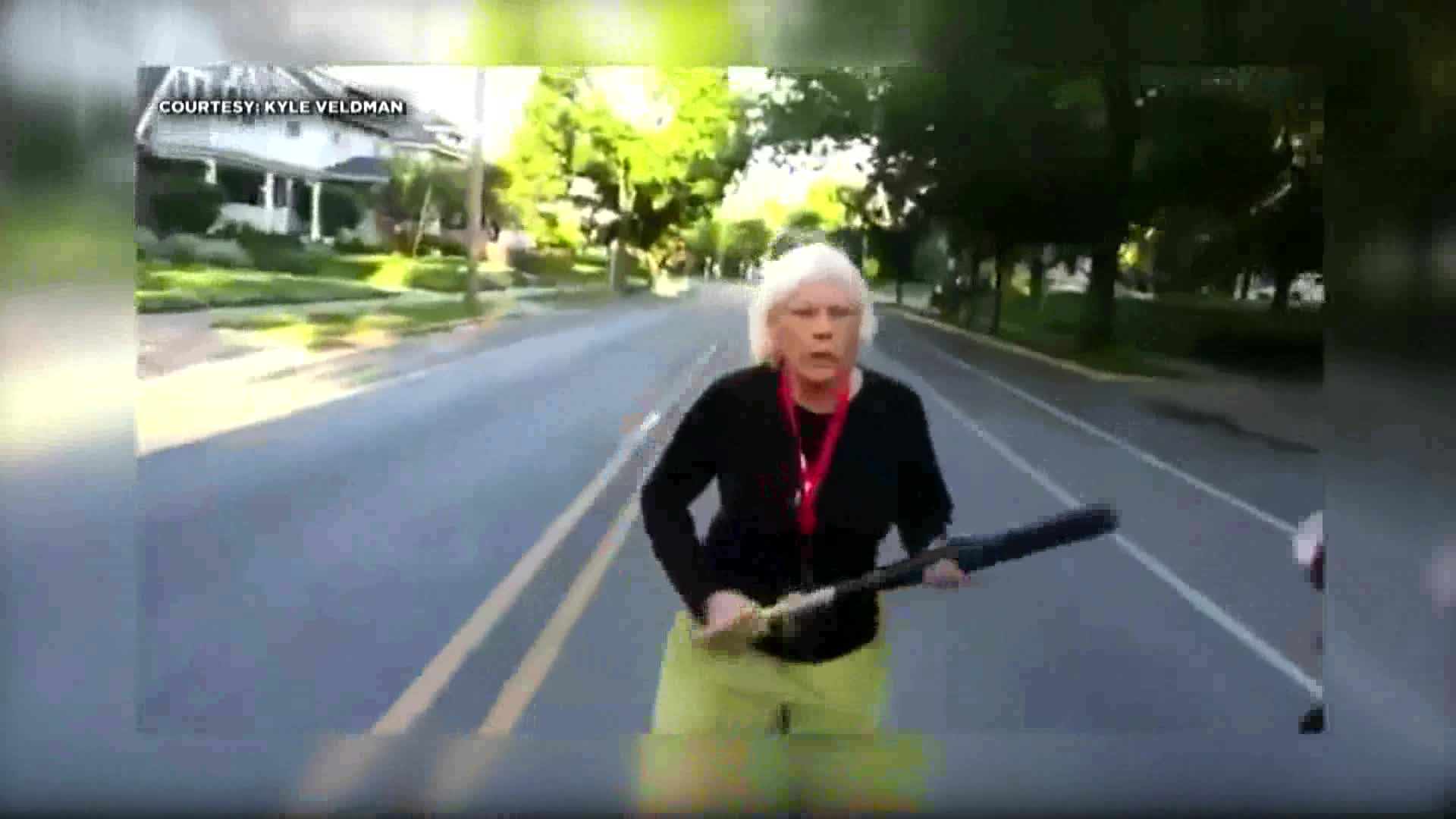 Grandmother wielding baseball bat confronts protesters marching through neighborhood