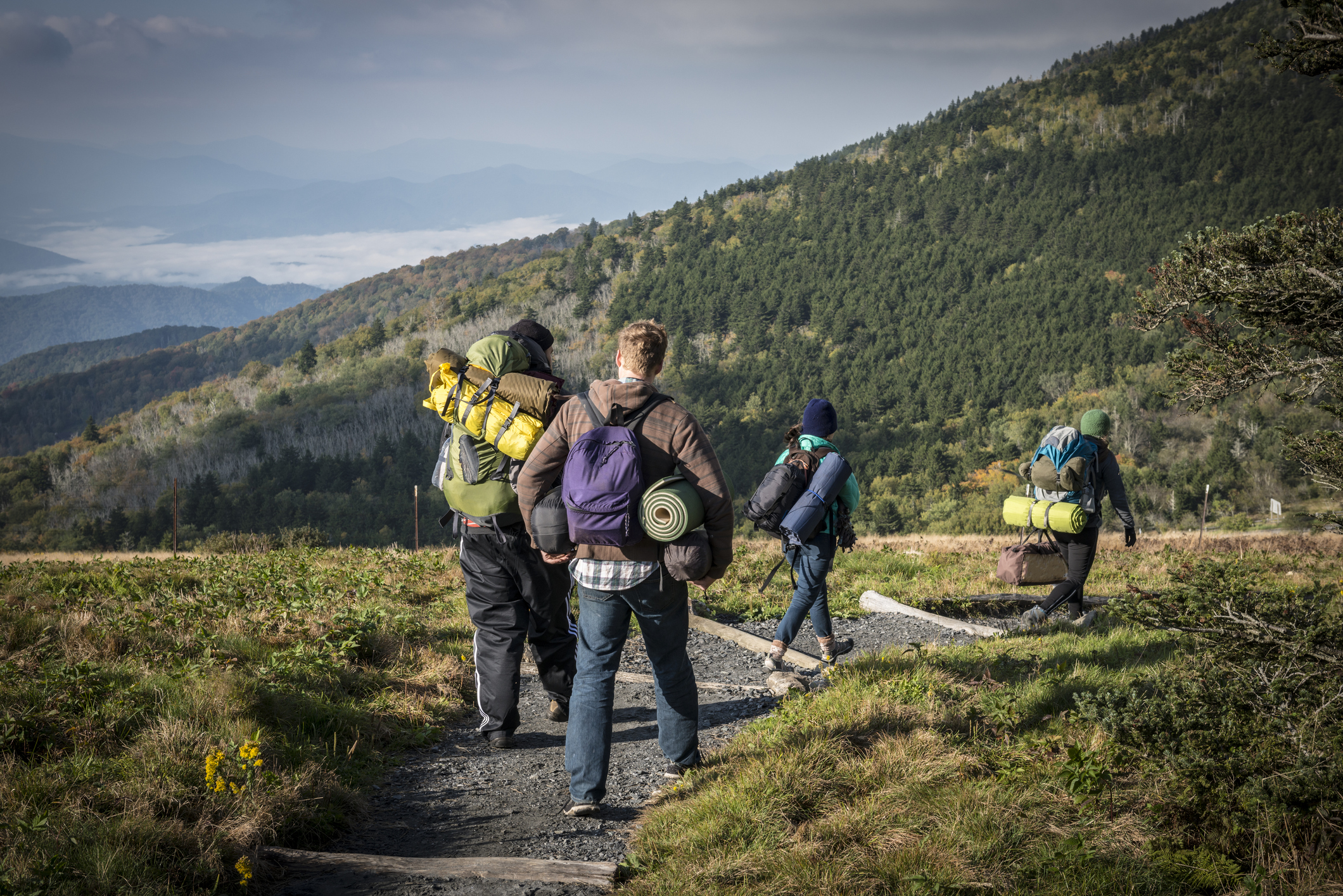 People walk on the Appalachian Trail after breaking camp on Roan Mountain. (Getty Images)