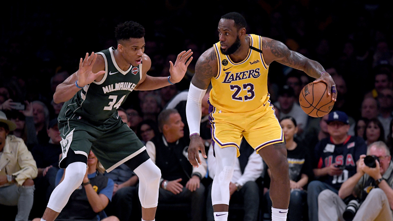LeBron James #23 of the Los Angeles Lakers backs in on Giannis Antetokounmpo #34 of the Milwaukee Bucks during the third quarter at Staples Center on March 6, 2020, in Los Angeles, California. (Photo by Harry How/Getty Images)