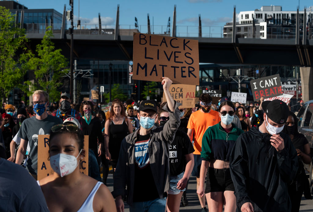 MINNEAPOLIS, MN - MAY 29: Protesters march by U.S. Bank Stadium in response to the police killing of George Floyd on May 29, 2020 in Minneapolis, Minnesota. Demonstrations and protests have been ongoing since Floyd's death in police custody on Monday. (Photo by Stephen Maturen/Getty Images)