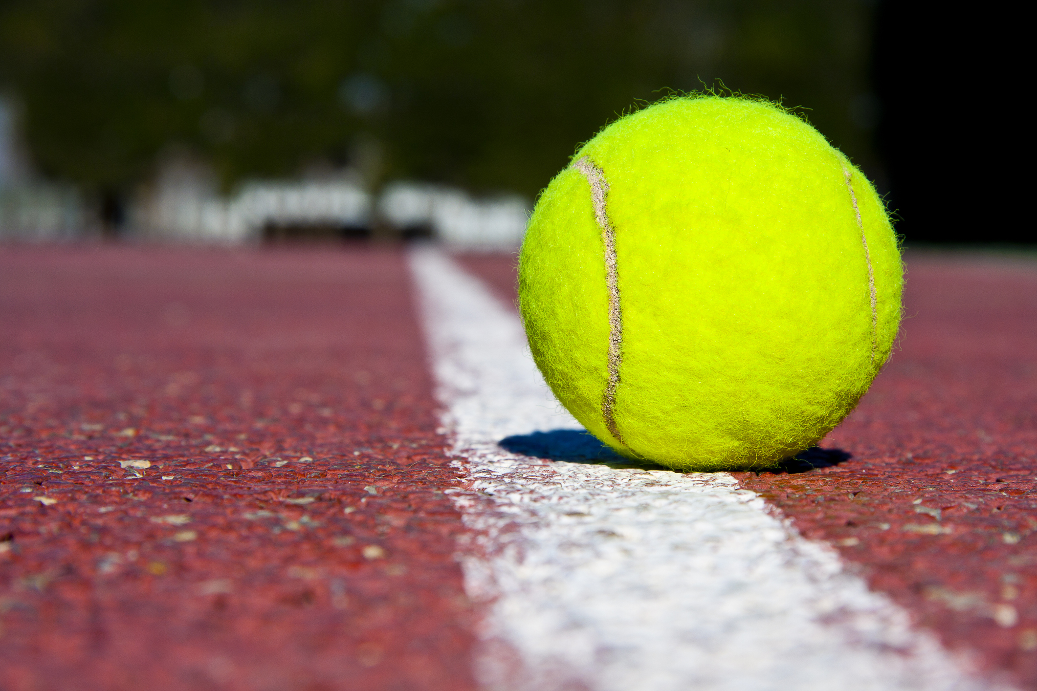 Tennis ball on tennis court. (Getty Images)