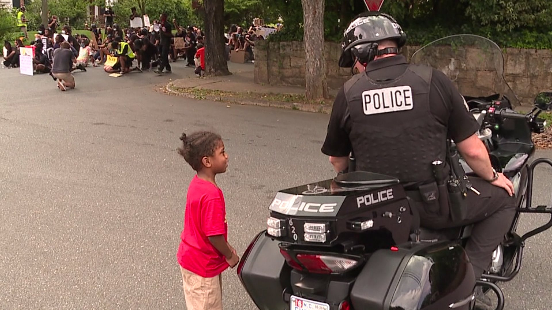Young boy has special moment with Winston-Salem police officer during protest