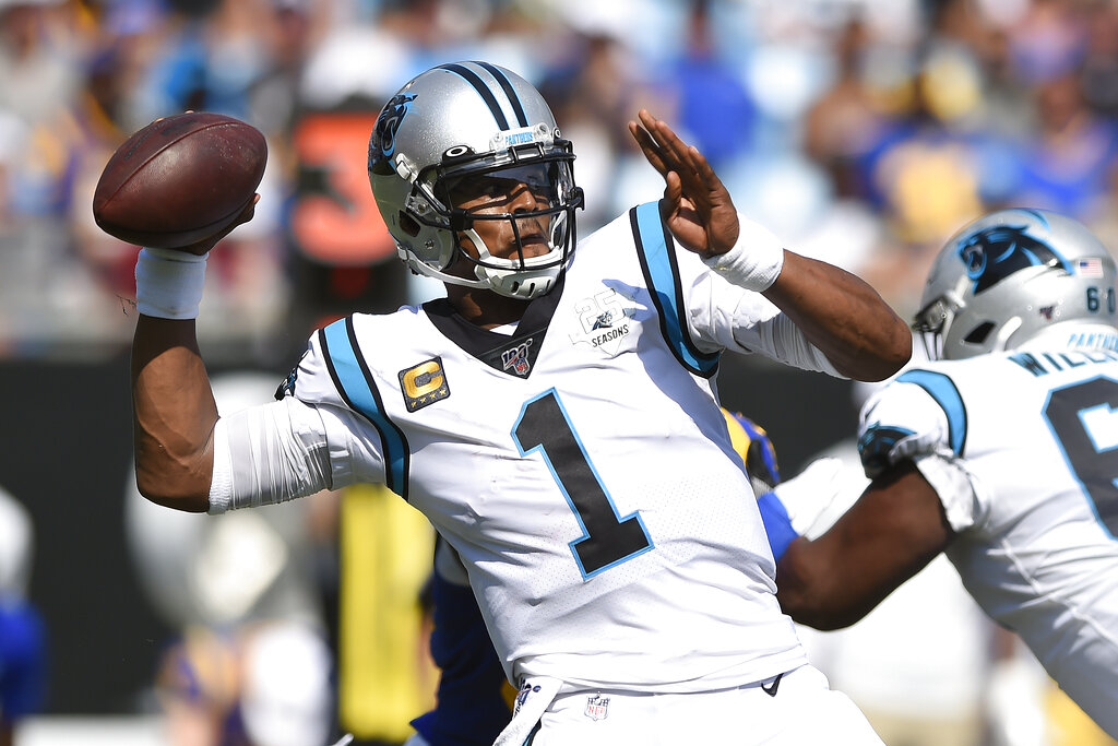 Carolina Panthers quarterback Cam Newton looks for a receiver during a game against the Los Angeles Rams. The New England Patriots have reached an agreement with free-agent quarterback Newton, bringing in the 2015 NFL Most Valuable Player to help the team move on from three-time MVP Tom Brady. (AP Photo/Mike McCarn, File)