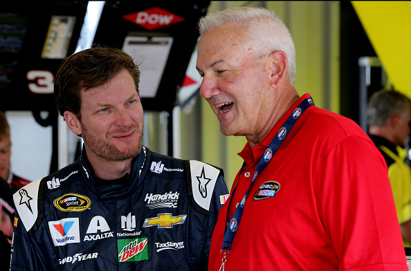 Dale Earnhardt Jr., driver of the #88 Nationwide Chevrolet, talks to NASCAR Hall of Fame driver and NBC announcer Dale Jarrett in the garage area during practice for the NASCAR Sprint Cup Series Quaker State 400 at Kentucky Speedway on July 7, 2016 in Sparta, Kentucky. (Photo by Jerry Markland/Getty Images)