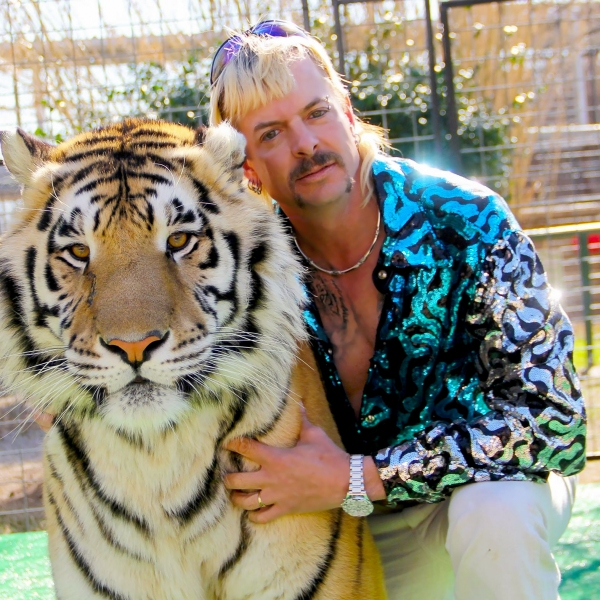 "Joseph Maldonado-Passage aka Joe Exotic and one of his cats in the Netflix docuseries ""Tiger King: Murder, Mayhem and Madness."" The docuseries has been a major hit for Netflix. Credit: NETFLIX/Courtesy of NETFLIX"