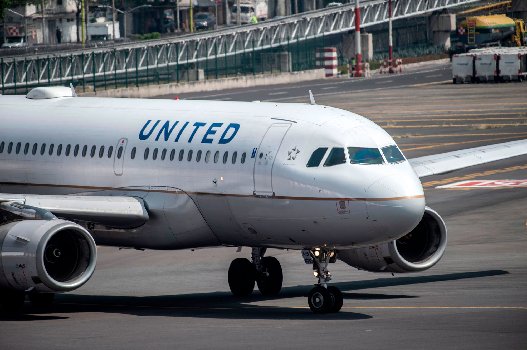 A United Airlines plane prepares to take off at the Benito Juarez International airport in Mexico City, on March 20, 2020. - International flights keep operating in Mexico, unlike most other countries which have closed airports due to the outbreak of the new coronavirus, COVID-19. (Photo by PEDRO PARDO / AFP) (Photo by PEDRO PARDO/AFP via Getty Images)