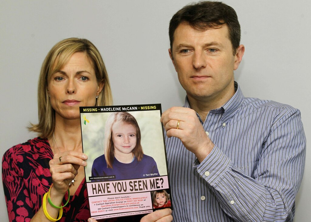 In this May 2, 2012 file photo, Kate and Gerry McCann pose with a missing poster depicting an age progression computer generated image of their daughter Madeleine at nine years of age, to mark her birthday and the 5th anniversary of her disappearance during a family vacation in southern Portugal in May 2007. McCann's family is hoping for closure in the case after a key suspect was identified in Germany and as authorities there say they believe the missing British girl is dead. (AP Photo/Sang Tan, File)