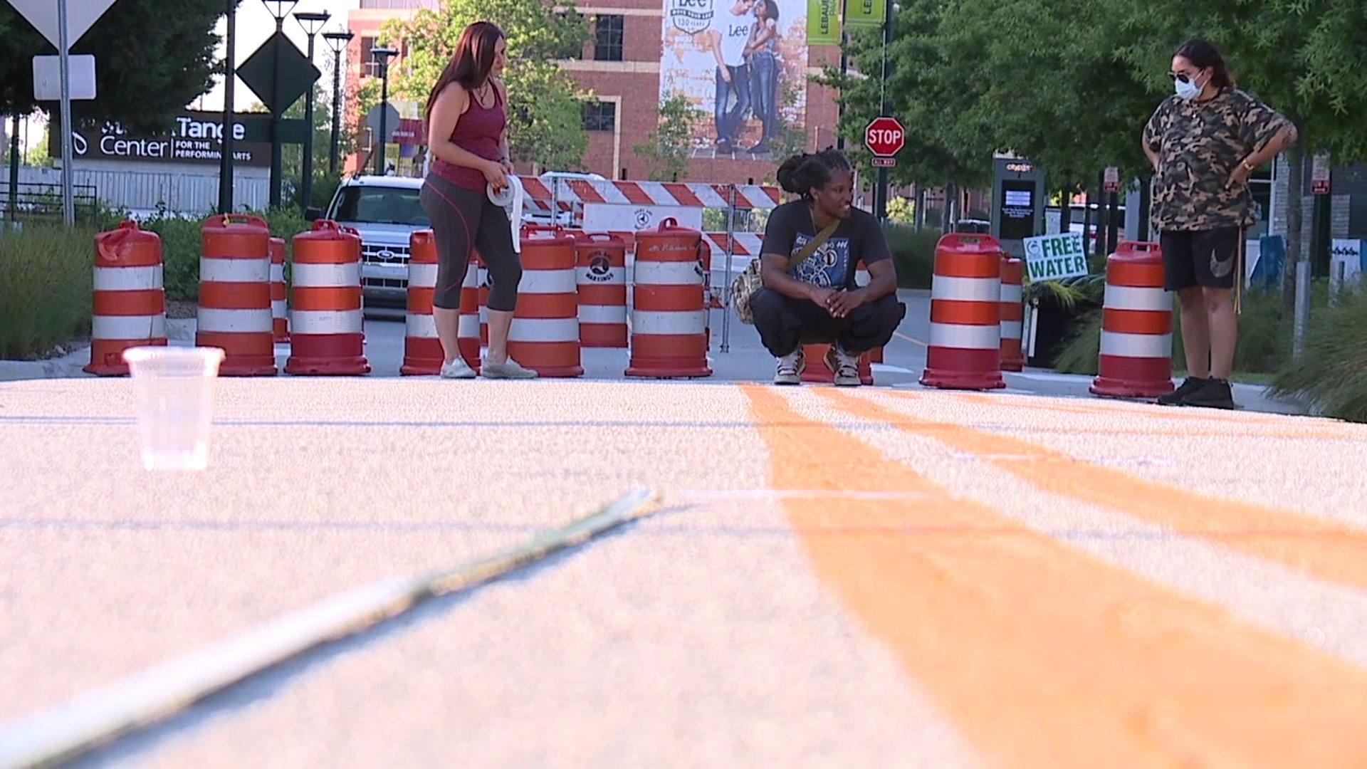 Work begins on new street mural in Greensboro