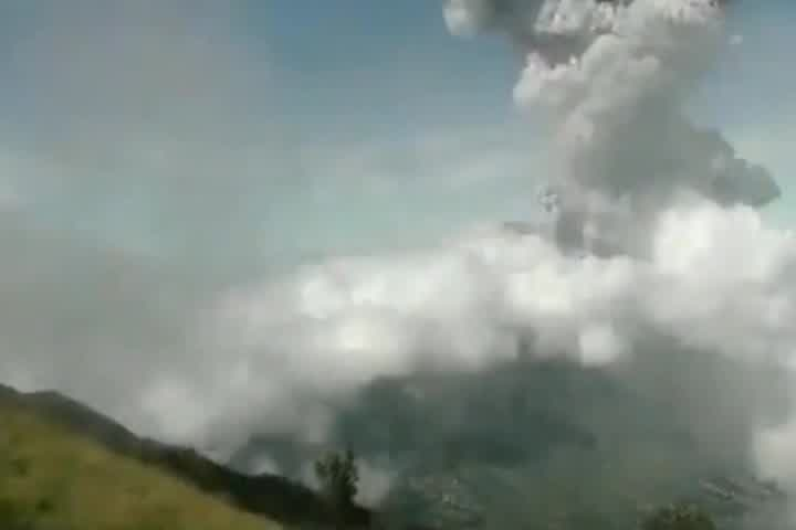 Indonesia's Mount Merapi erupted twice on Sunday, sending clouds of ash nearly four miles up into the sky.