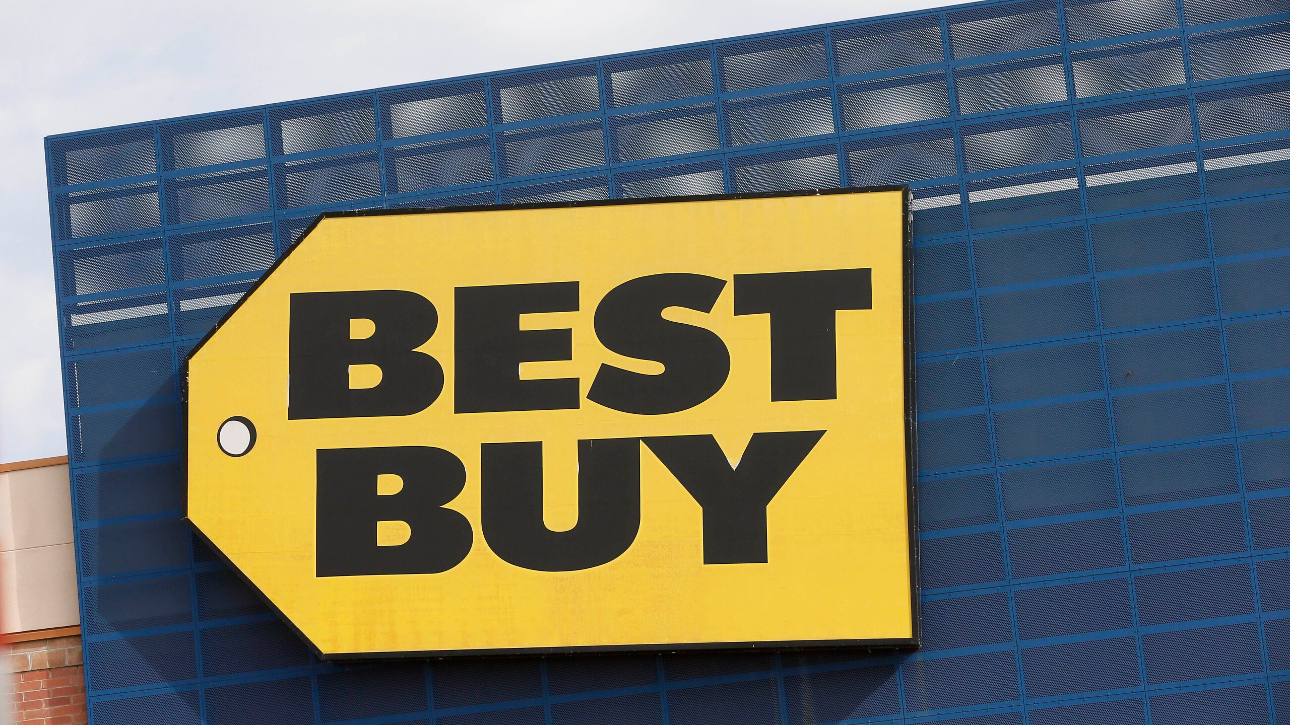 FILE - In this Aug. 27, 2019, file photo, the Best Buy logo is shown on a store in Richfield, Minn. (AP Photo/Jim Mone, File)