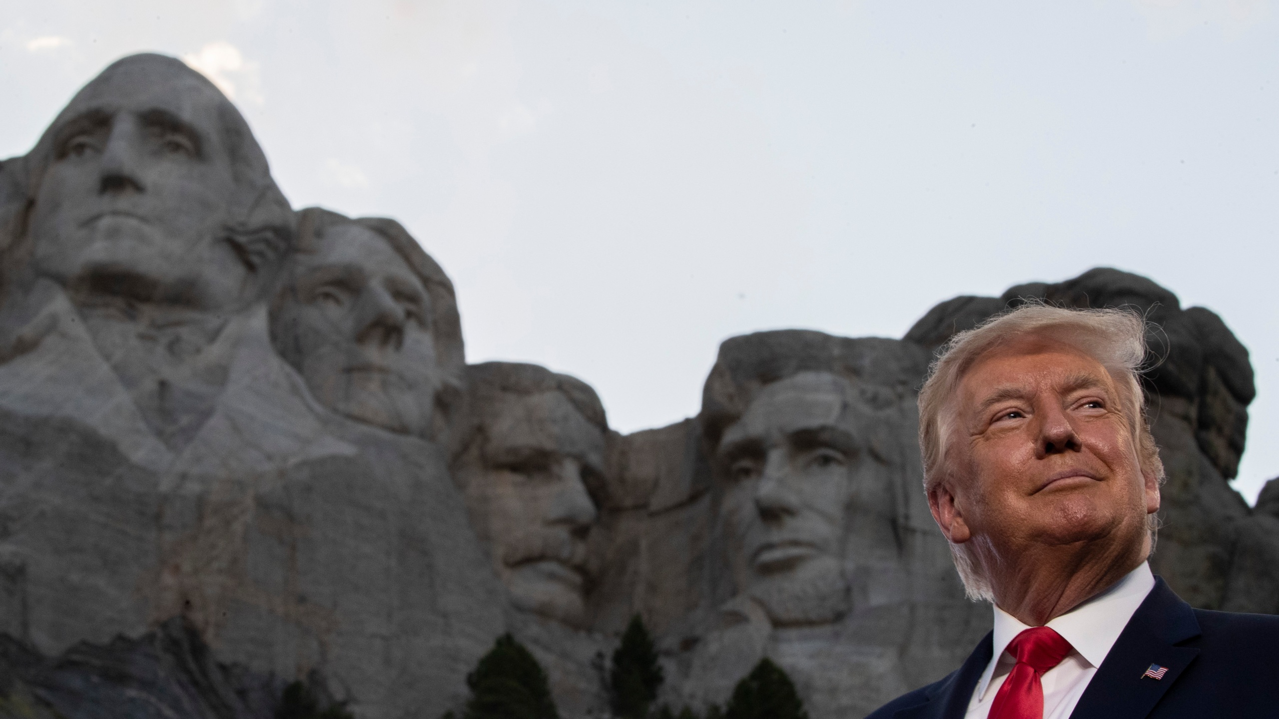 President Donald Trump smiles at Mount Rushmore National Memorial, Friday, July 3, 2020, near Keystone, S.D. (AP Photo/Alex Brandon)