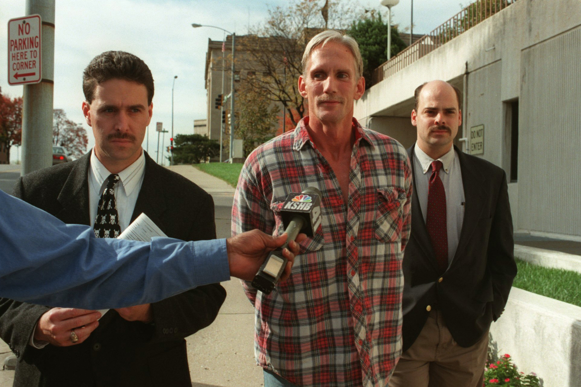 In this 1998 photo, Wesley Ira Purkey, center, is escorted by police officers in Kansas City, Kan., after he was arrested in connection with the death of 80-year-old Mary Ruth Bales. Purkey was also convicted of kidnapping and killing a 16-year-old girl and is scheduled to be executed on July 15, 2020, in Terre Haute, Ind. (Jim Barcus/The Kansas City Star via AP)